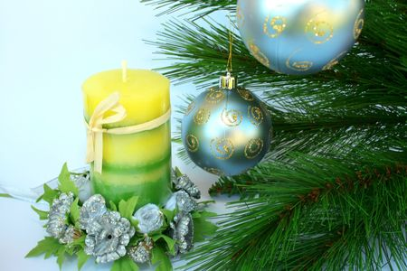 Christmas ornaments.Gray balls,fir-tree,candle,flowers. photo