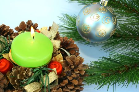 Christmas ornaments.Gray ball,fir-tree,candle,cones. photo