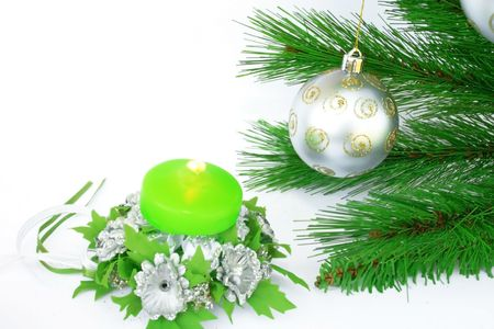 Christmas ornaments.Gray ball,fir-tree,candle,silvery flowers. photo