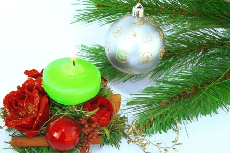 Christmas ornaments.Gray ball,fir-tree,candle,holly-berry,rose. Stock Photo - 2096817