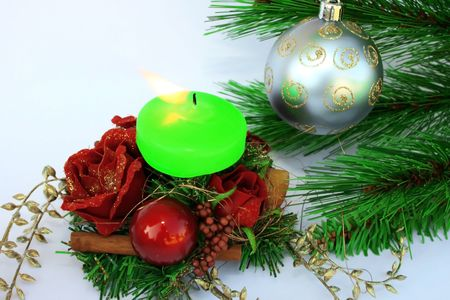 Christmas ornaments.Gray ball,fir-tree,candle,holly-berry,rose. photo