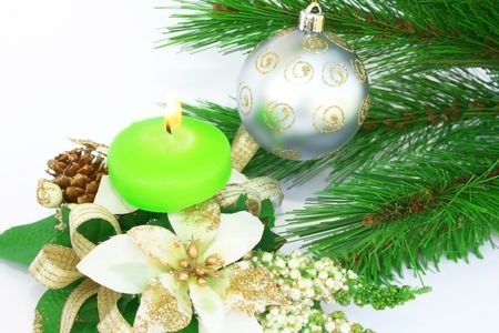 Christmas ornaments.Gray ball,fir-tree,candle,flowers,cone. photo