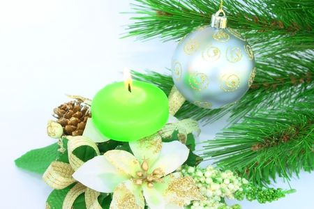 Christmas ornaments.Gray ball,fir-tree,candle,cone,flowers. photo