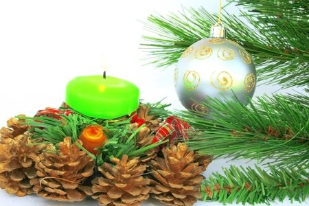 Christmas ornaments.Gray ball,fir-tree,candle,cones. Stock Photo - 2096833