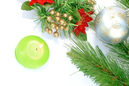 Christmas ornaments.Gray ball,fir-tree,candle,flowers. photo