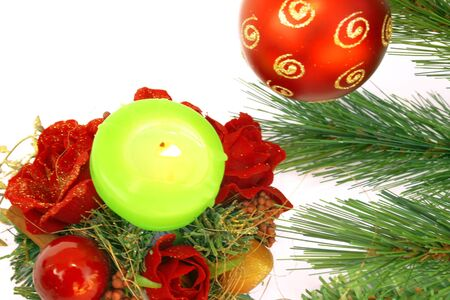 Christmas ornaments.Red ball,fir-tree,candle,holly berry,rose. photo