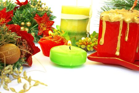 Christmas ornaments.Candles,holly berry,fir-tree. photo
