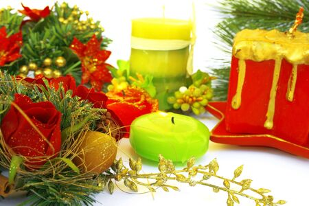 hollyberry: Christmas ornaments.Candles,holly-berry,rose,fir-tree. Stock Photo