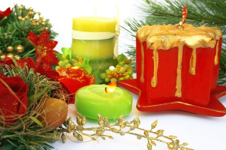Christmas ornaments.Candles,holly-berry,rose. photo