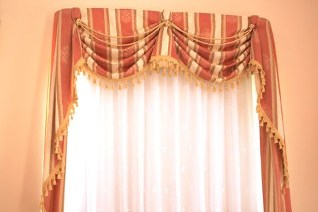 yellow tassel: The picture of luxurious curtains at home.