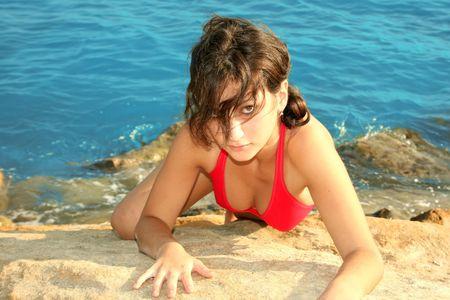 The girl in red bikini on the beach. photo