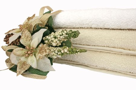Stack of clean and colorful towels with flowers isolated on the white. Stock Photo - 2948661