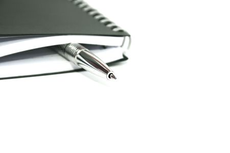 Silvery pen in the black note-book. Stock Photo