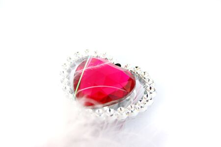 Red heart stone on white background. photo