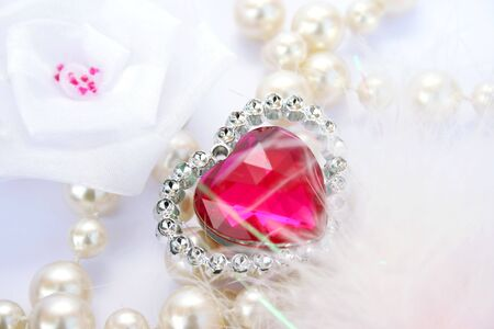Red valentine heart,pearlsand white ribbon. photo