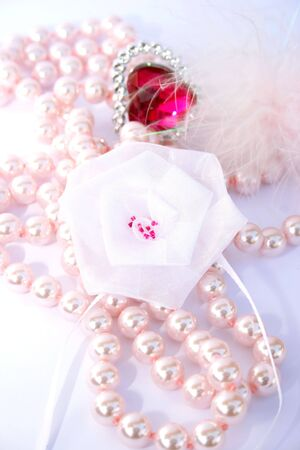 Red valentine heart,pink pearls,white ribbon. photo