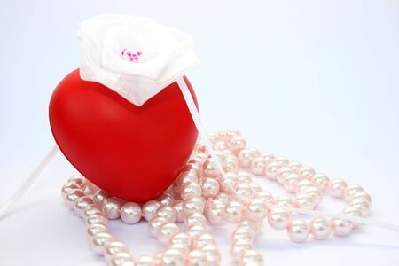 Red valentine heart,white ribbon,pink pearls. Stock Photo - 4149897