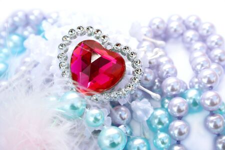 Valentine red heart,colorful pearls and feather. Stock Photo - 4149904