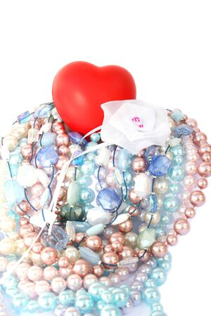 Red valentine heart,colorful pearls,beads,white ribbon. Stock Photo - 4156766