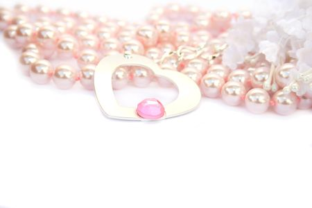 Necklace with heart and pink stone on it,pink pearls and white fabric flowers. Stock Photo - 4156755
