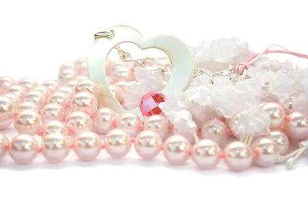 Necklace with heart and pink stone on it,pink pearles and white fabric flowers. Stock Photo - 4156757