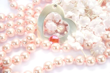 Necklace with heart and pink stone on it,pink pearls and white fabric flowers. Stock Photo - 4156764