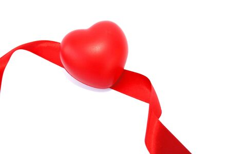 Red valentine heart and ribbon on white background. photo