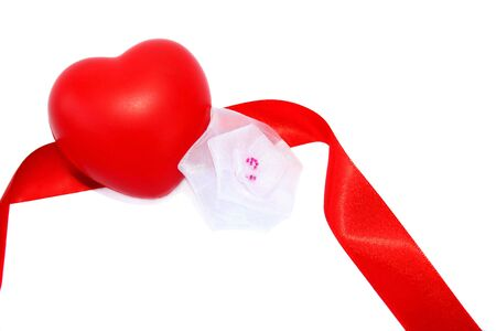 Red valentine heart, ribbon and white fabric flower on white background. photo