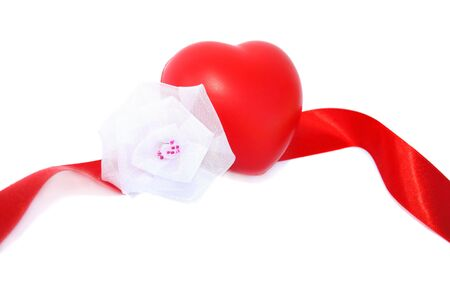 Red valentine heart,ribbon and white fabric flower on white background. photo
