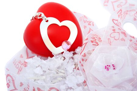 Red valentine heart, ribbon,silver heart,fabric flowers on white background. photo