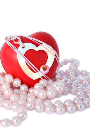 Valentine hearts and pink pearls on white background. photo