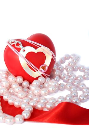 Valentine hearts,red ribbon,pink pearls on white background. photo