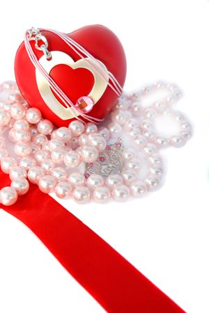 brilliants: Valentine hearts,red ribbon and pink pearls on white background.