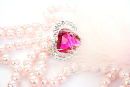 brilliants: Red heart stone and pink pearls. Stock Photo
