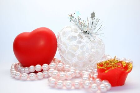 Valentine red and white hearts,pink pearls and red candle. Stock Photo - 4191514