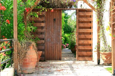 door leaf: Vintage door entrance to the backyard. Stock Photo