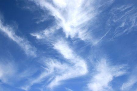 White fantastic clouds in blue sky. photo