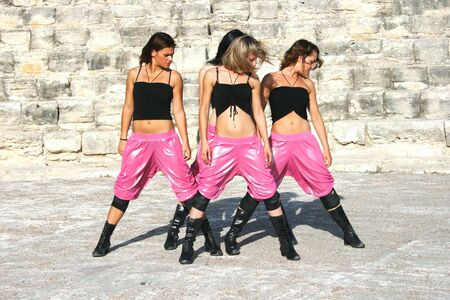 Beautiful modern dancers on the ancient stairs of  Kurion amphitheatre in Cyprus. photo