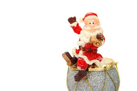St.Clause holding bell,sitting on the drum. photo