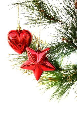 Christmas star and heart hanging on fir tree isolated on white background. photo