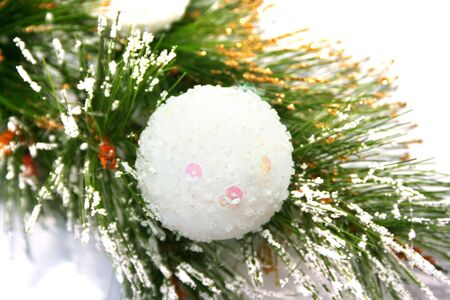 Christmas ball on fir tree isolated on white background. photo