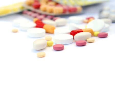 prescriptions: Close-up medical pills and tablets background.