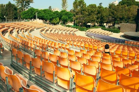 amphitheatre: Plastic yellow chairs in summer amphitheatre.