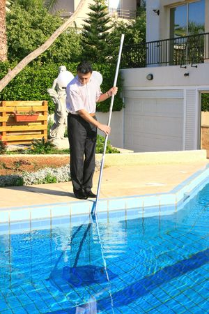 Swimming pool cleaner at  work. photo