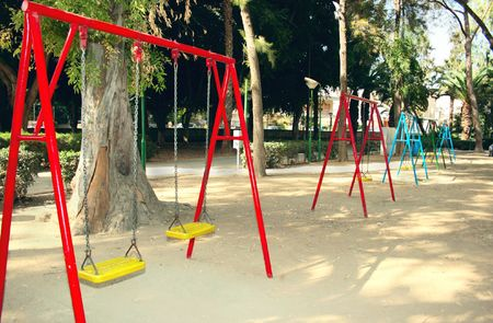 Swing chairs in playing garden. photo