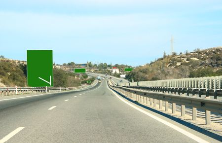 Road and billboards on it. photo