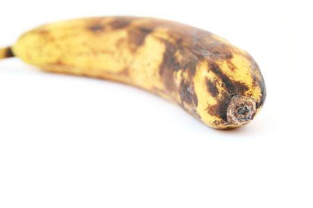 Aging banana isolated on white background. photo