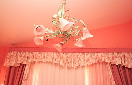 Luxurious flowers chandelier hanging in room. photo