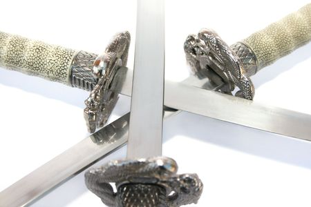 Three daggers isolated on white background. Stock Photo - 5877761