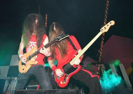 headbang: Bassist and guitarist  of heavy metal band.
